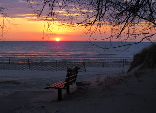 sunset over Lake Michigan with bench