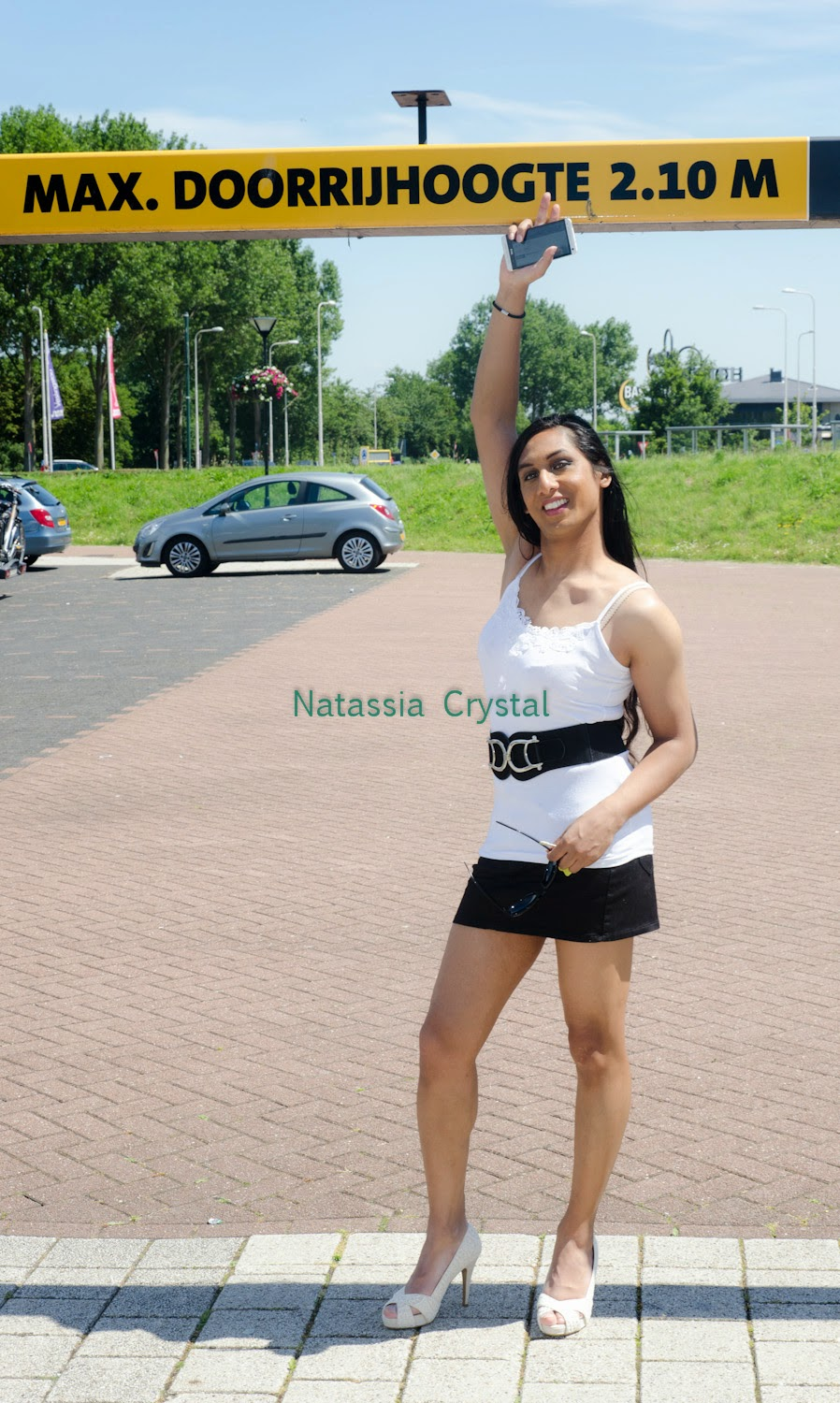 Natassia Crystal natcrys, short black skirt, white top, outside at parking place
