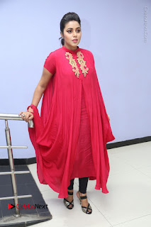 Actress Poorna Latest Stills in Red Dress at Rakshasi First Look Launch  0313.JPG