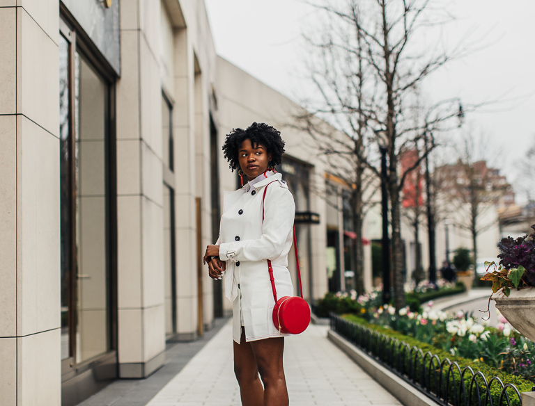 Blogger wearing white jacket and skirt