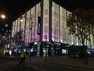 Christmas light on front and side views of House of Fraser store
