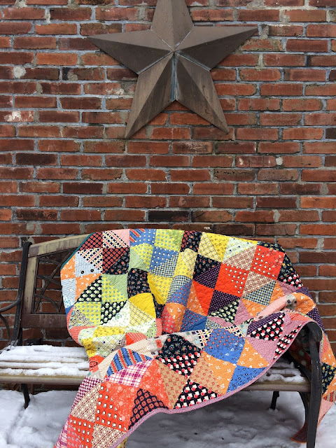 simple twin sized scrappy quilt made with Denyse Schmidt's Stonington fabric