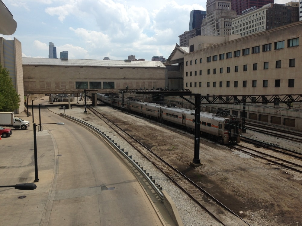 A grey concrete area in Chicago with a railway