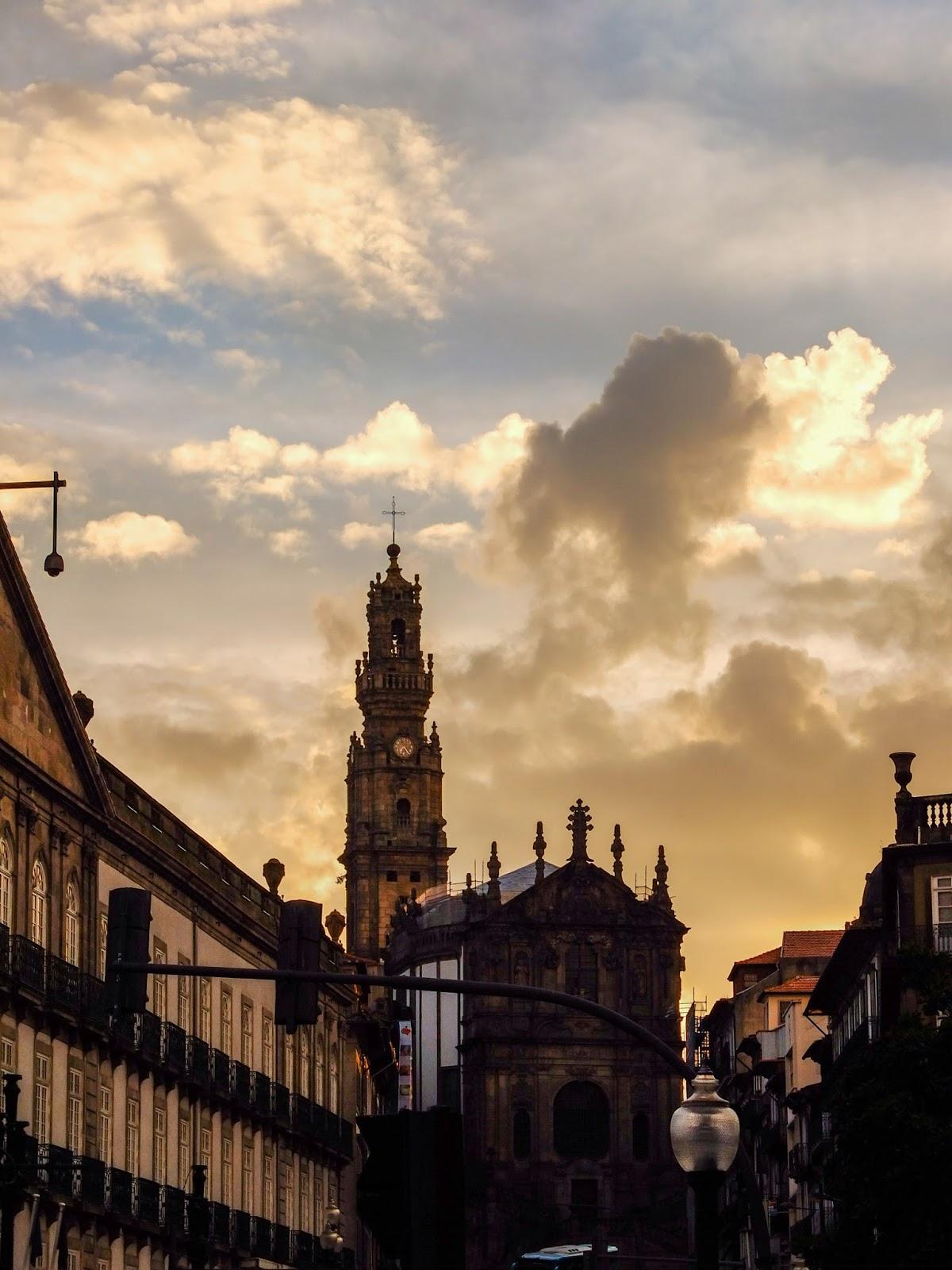 The Baroque 18th century Clérigos Church at sunset from Rua dos Clerigos in Porto, Portugal.