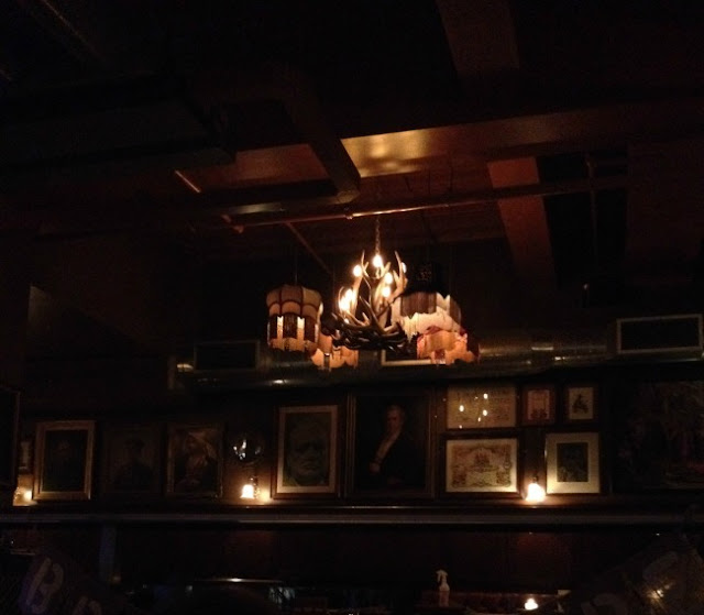picture of inside of Cosy Club. Dark with subtle lighting