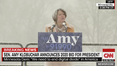 Amy Klobuchar hears America singing.