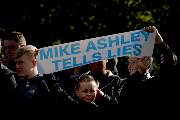 Newcastle United fans protest against chairman Mike Ashley outside the stadium prior to the Premier League match between Newcastle United and Leicester City at St. James Park on September 29, 2018 in Newcastle upon Tyne, United Kingdom