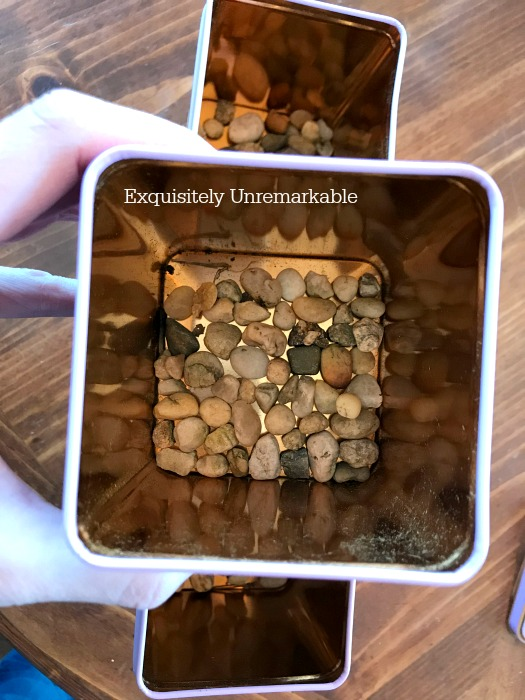 Adding Pebbles To Tins For Drainage