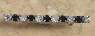 Black and clear diamante bar brooch