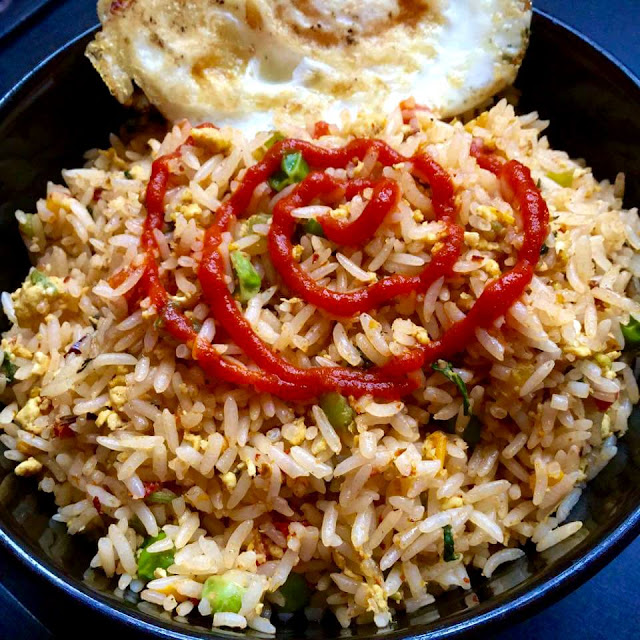 Oriental Egg Fried Rice served with a Fried EggFlavors Of Rice International Cuisine