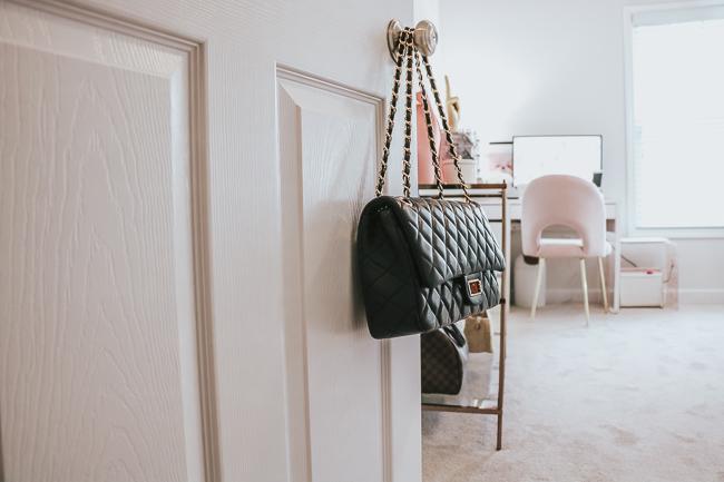 black quilted bag on door knob