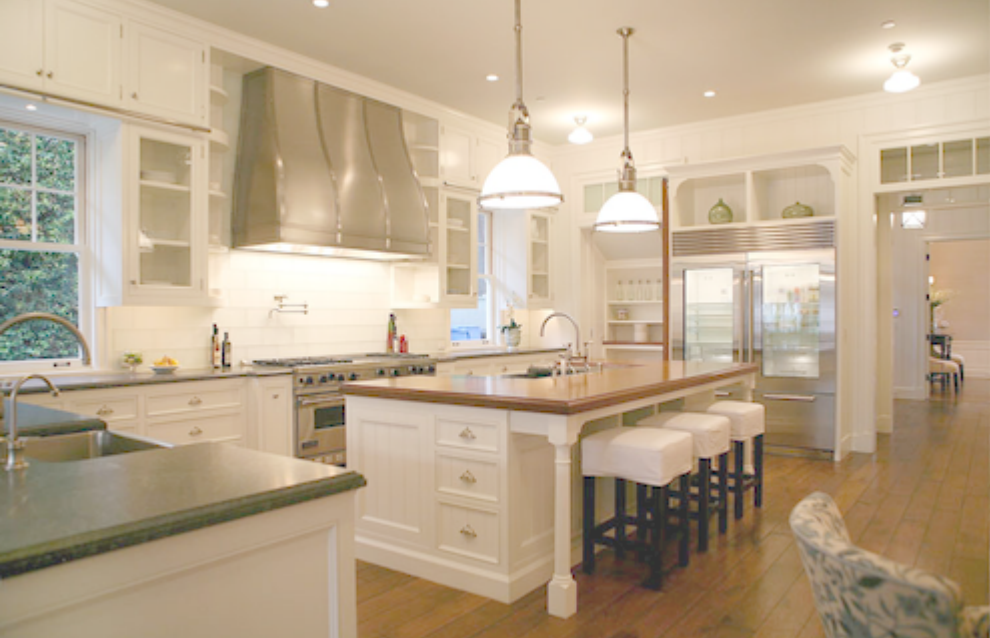 Gorgeous white cottage style kitchen in Giannetti Home with walnut flooring