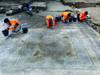 INRAP workers work round the edges of the largest mosaic featuring the animal images [Credit: Denis Gliksman, INRAP]