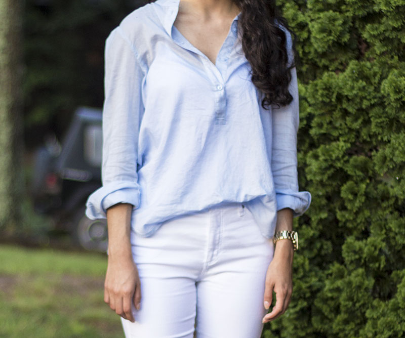 light blue button up shirt and white jeans outfit