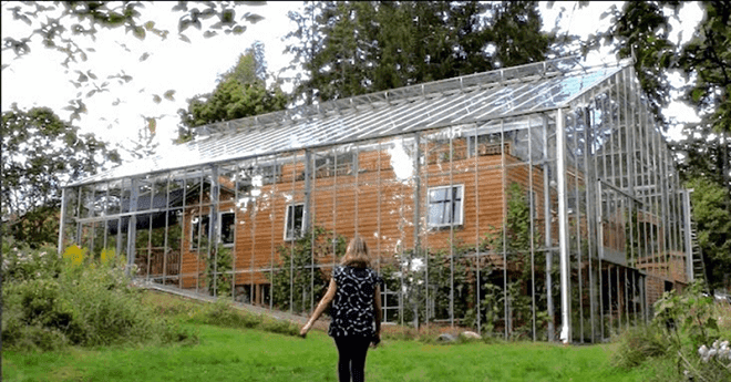Brilliant Idea: Couple Builds Greenhouse Around House To Grow Food And Keep Warm