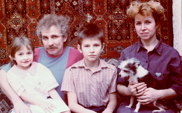 Family photo against Russian carpet
