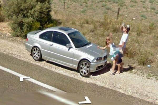 18 Hilariously Weird Moments Captured On Google Street View - Posing for photos in an inappropriate position in the middle of the street