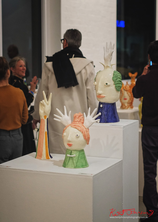 Ceramic heads with waving hands by Caroline Gibbes - Photography by Kent Johnson. Photography by Kent Johnson.