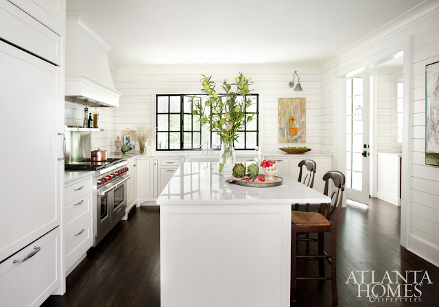 Showstopping white kitchen with shiplap, modern art, and black accents