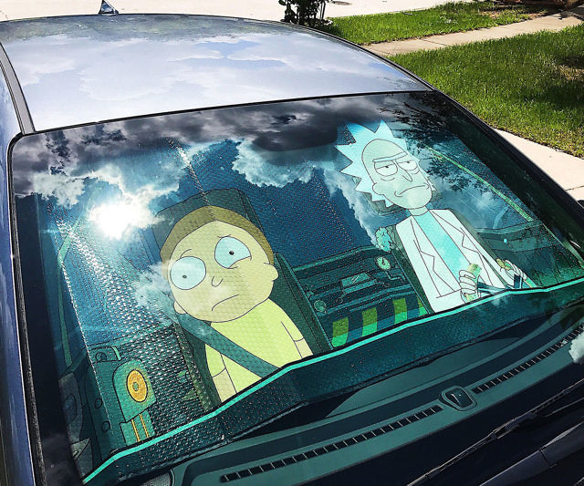 Prevent harmful UV rays from damaging your ride's interior by keeping your car cool with this Rick and Morty windshield sunshade. This accordion sunshade creates the illusion that Rick and a reluctant Morty are piloting your vehicle while you're away.