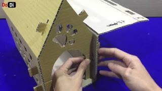 Rumah kucing dari kardus