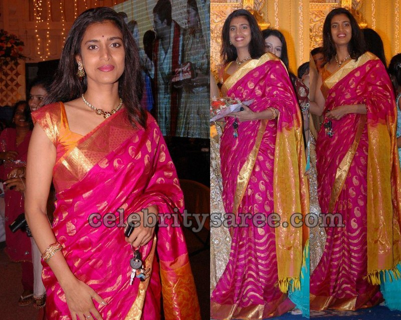 b0c26865e3 South Indian actress kasthuri in bright pink traditional kanjivaram silk  bridal saree with gold border and gold woven work over the saree, ...