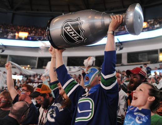 Canucks fan Neil Evans hoists an inflatable Stanley Cup ... 5756531affbe