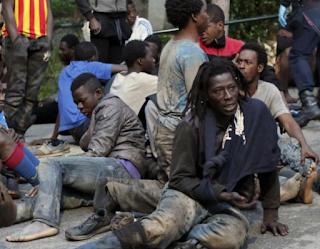 Almost 500 Migrants Smash Through Border Fence Into Spain