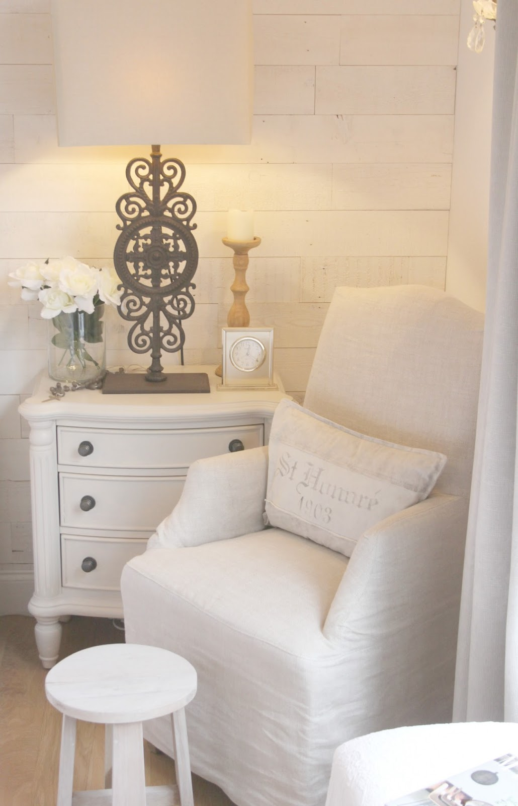 Belgian linen armchair and nightstand in master bedroom in Hello Lovely Studio fixer upper