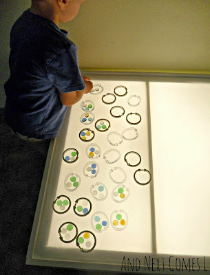 Grouping on the light table using shower curtain rings and glass stones from And Next Comes L