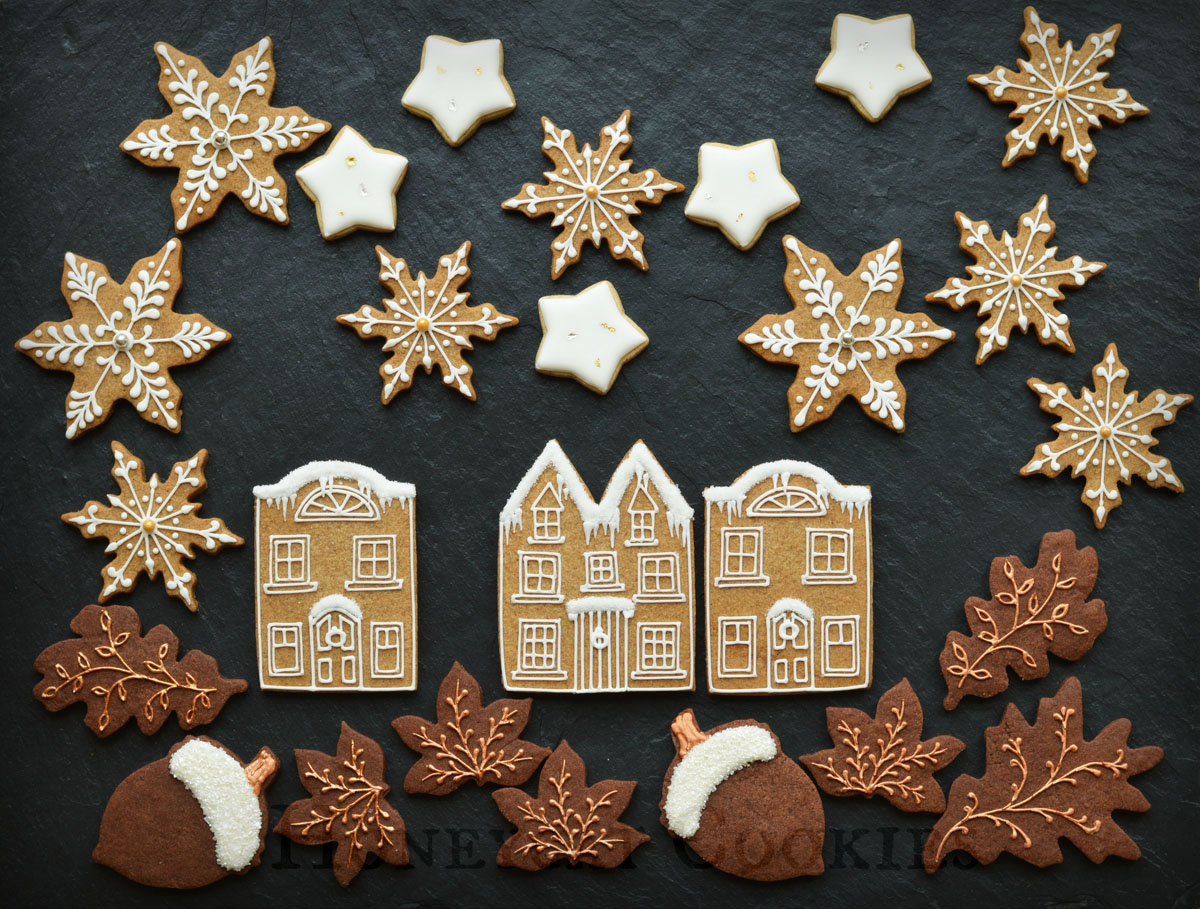 Town scene made of gingerbread, chocolate and vanilla decorated cookies, by Honeycat Cookies