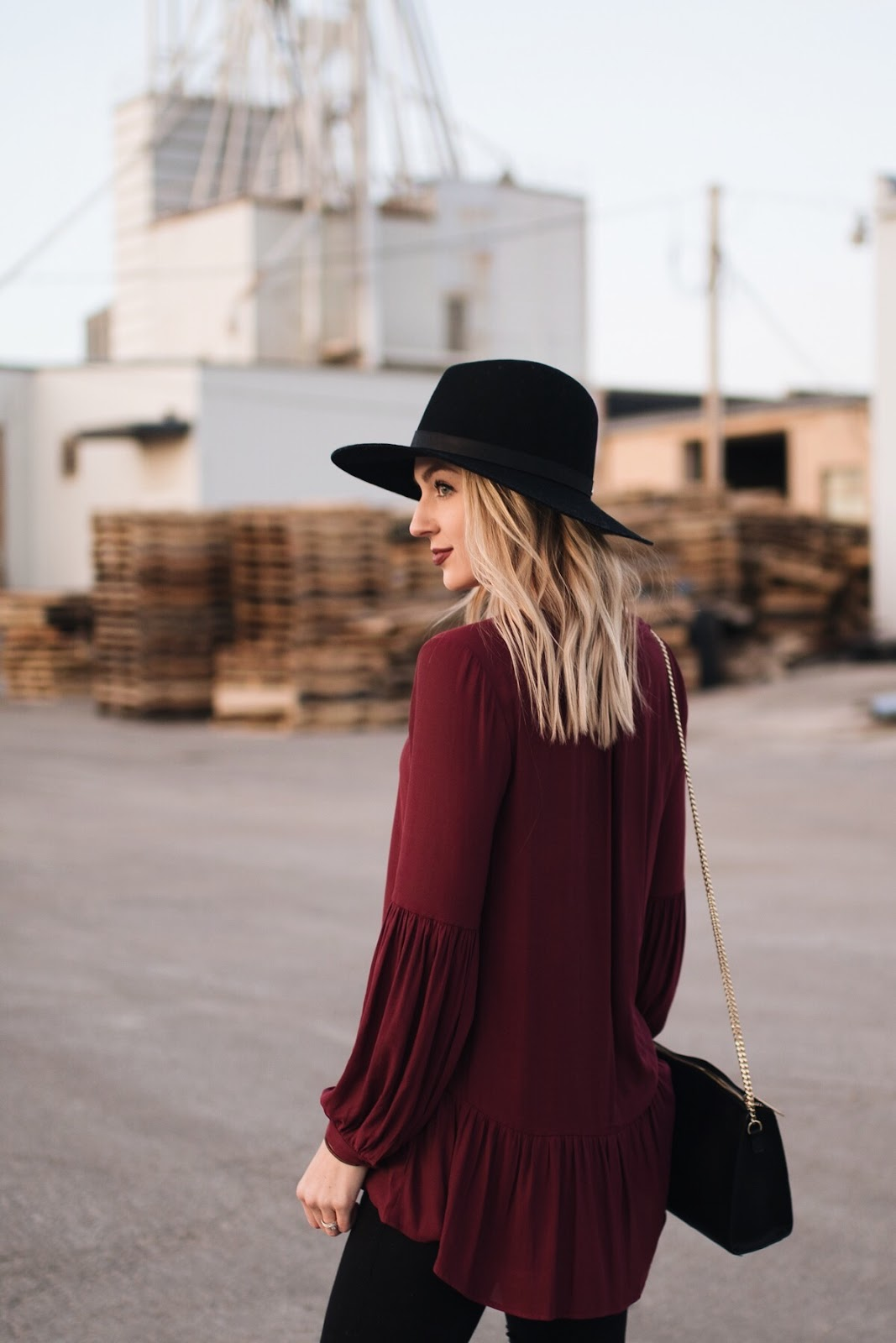 burgundy tunic blouse paired with black