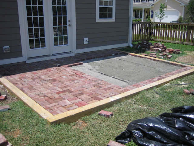 Replacing concrete patio with brick in double basket weave pattern for a cottage look and feel | The Lowcountry Lady