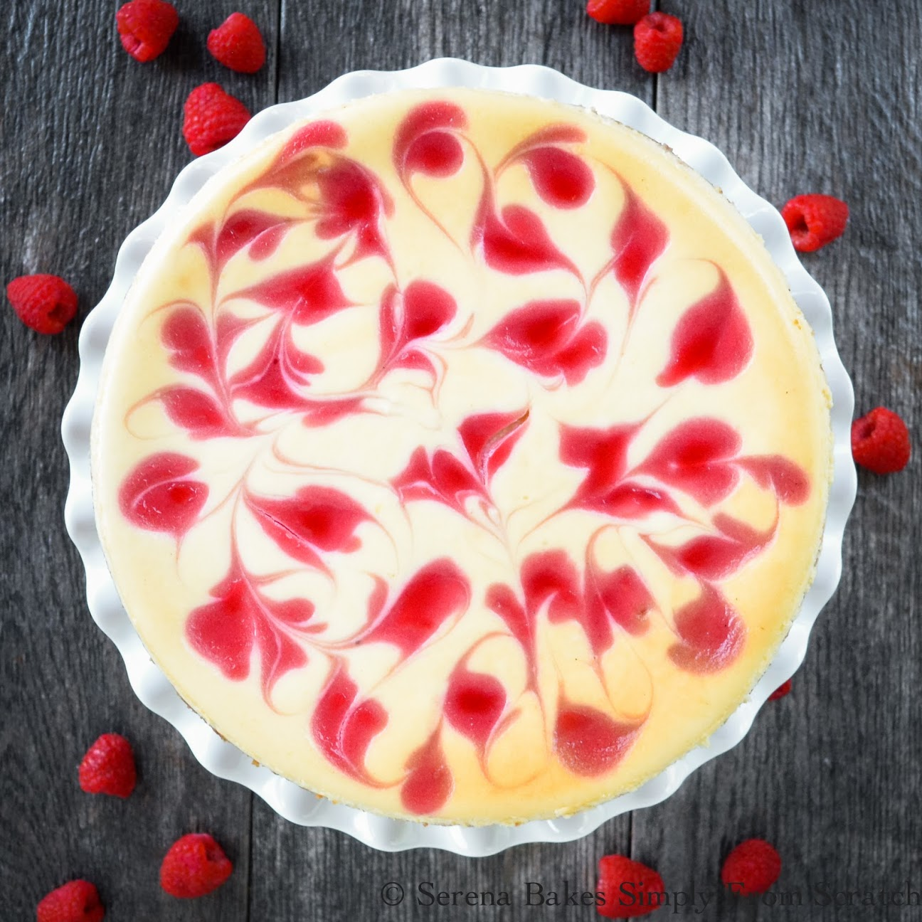 Tall Creamy Lemon Cheesecake with Raspberry Swirl is perfect dessert for Christmas & the holidays!
