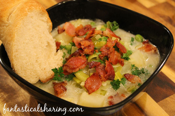 Potato Leek Soup with Bacon //  This delicious potato soup is paired with leeks and peas...and bacon! #recipe #soup #bacon #potato