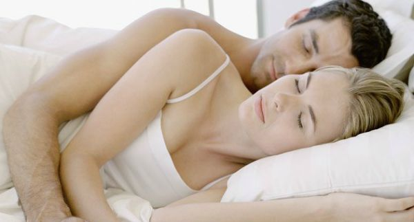 Why Some People Sleep Better With Another Person In Bed