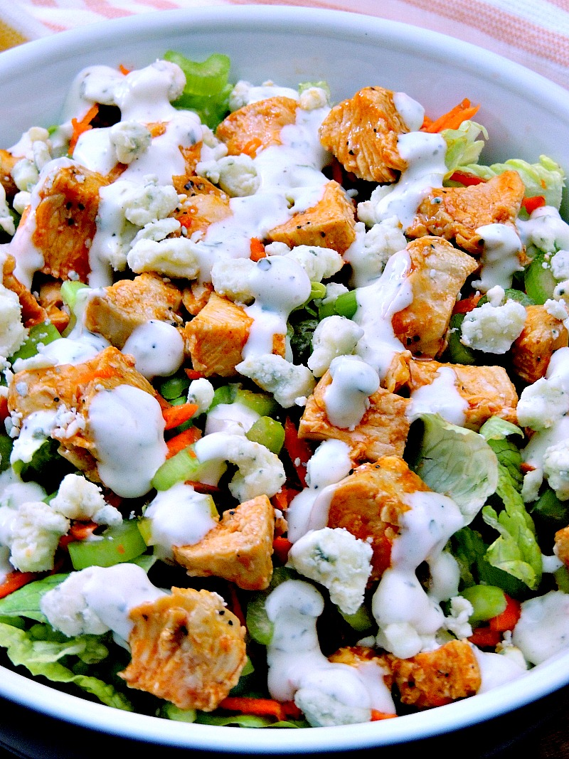 Buffalo Chicken Chopped Salad - Trying to eat lighter doesn't mean you have to forgo your favorite foods. It just takes a little imagination. This Buffalo Chicken Chopped Salad recipe provides all of those Buffalo Chicken Wing flavors you crave minus extra carbs! #salad #buffalochicken #lowcarb #keto #lunch #Healthy #easy #recipe | bobbiskozykitchen.com