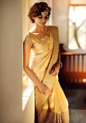 Custom border on a gold bridal silk saree with match color blouse design is simply perfect.