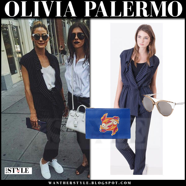 Olivia Palermo in blue stripe vest, striped trousers, white sneakers with blue clutch dfv zodiac what she wore