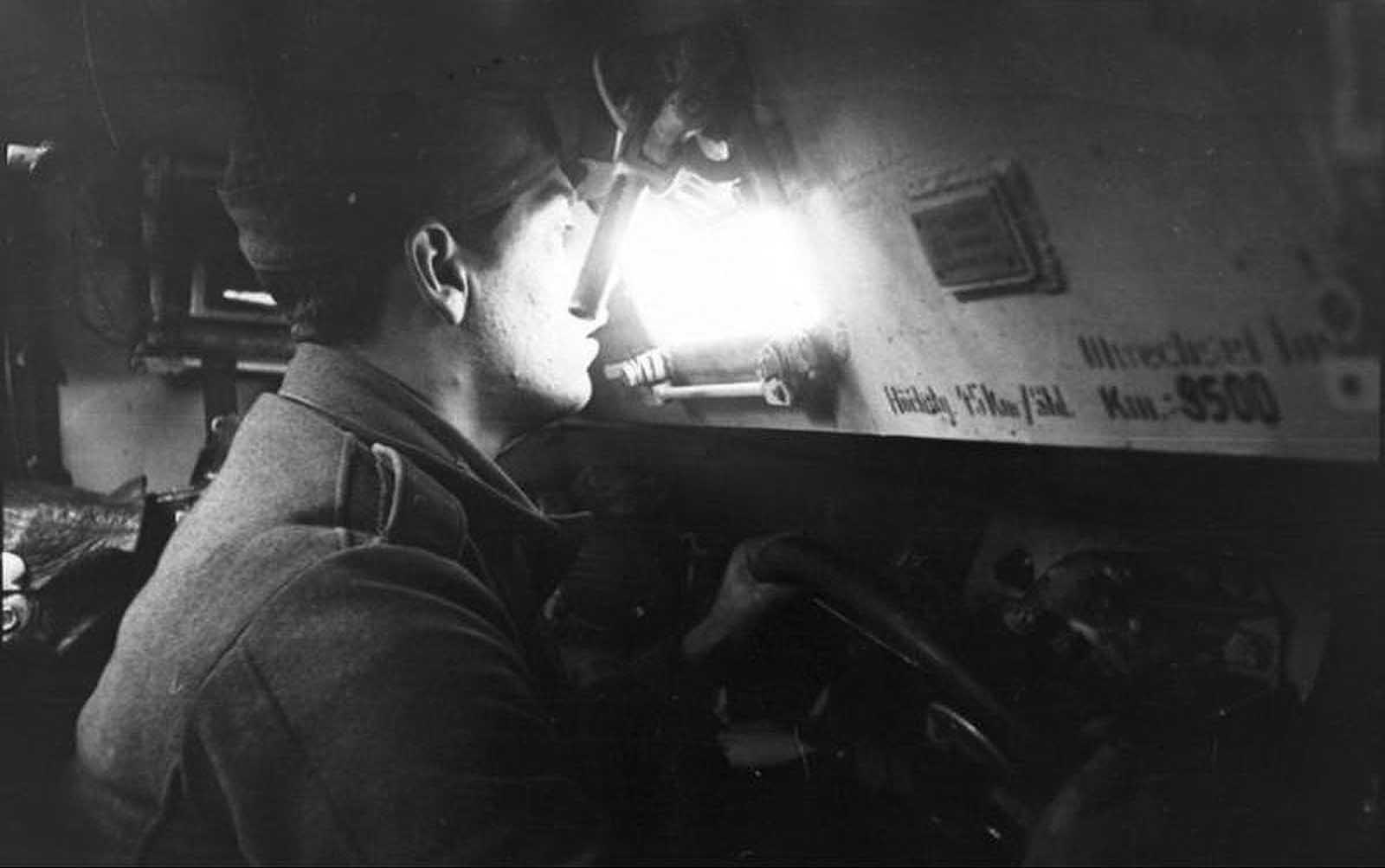 A German half-track driver inside an armored vehicle in Russia in August of 1941.
