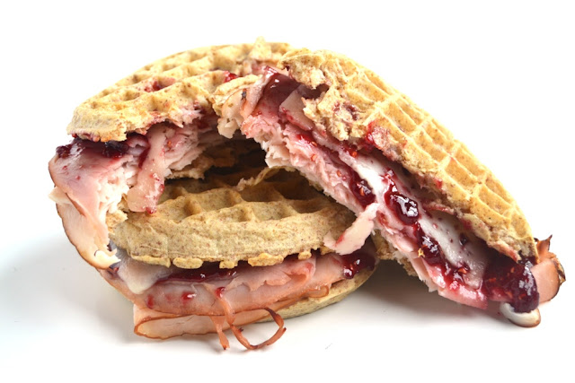 Monte Cristo Waffle Sandwiches only have 5 ingredients and take just 10 minutes to make! The perfect blend of sweet and savory with melted Swiss cheese, raspberry jam, turkey and ham on crispy whole-grain waffles. www.nutritionistreviews.com