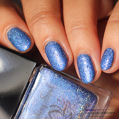 Nail polish swatch of Prom Night by Soothing Soul Nail Lacquer is a cerulean blue polish with holo glitter