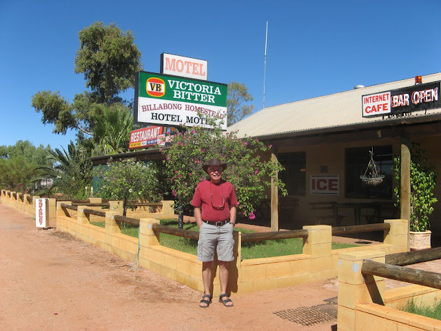 man in Ozzie hat, standing outside of a roadhouse in Australia