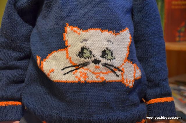 sweter z kotkiem