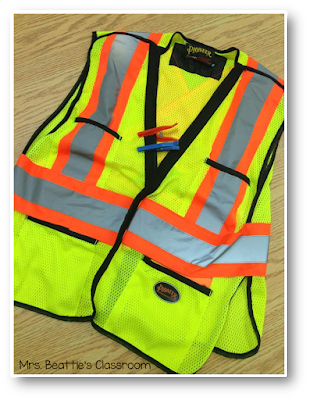 Photo of security vest with clothespin hall passes