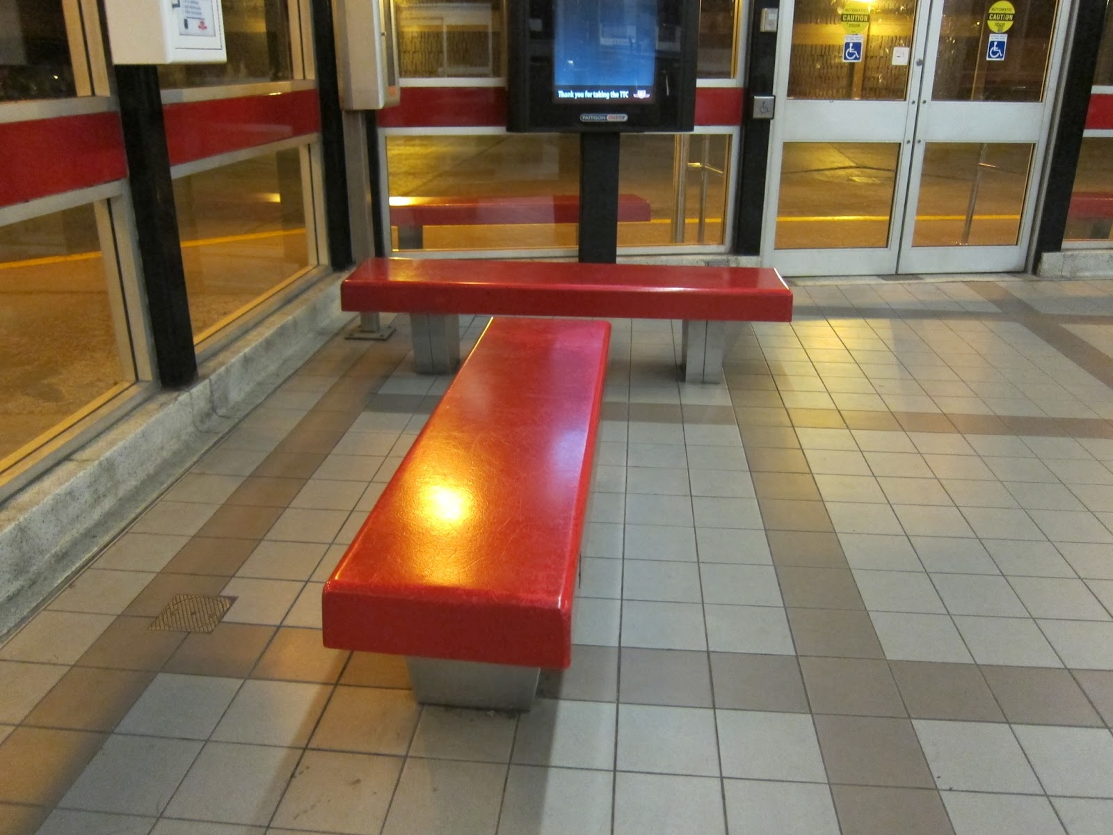 Benches in the main bus platform waiting area at Donlands station