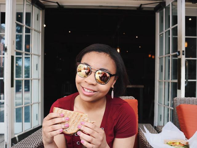 Lauren Alston wearing Lulu's sunglasses and top at Tru Deli.