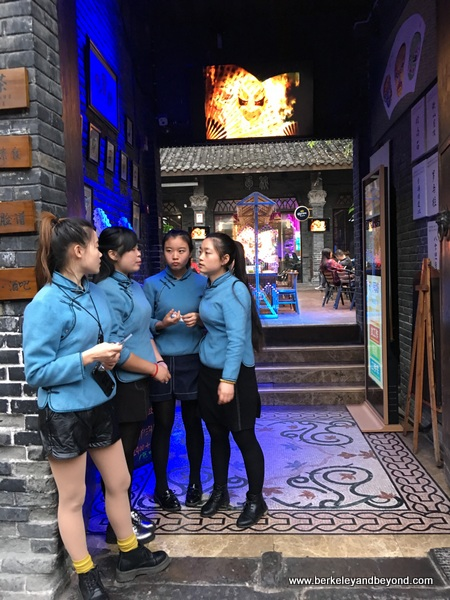 girls at entrance to restaurant in Narrow Alley in Chengdu, China