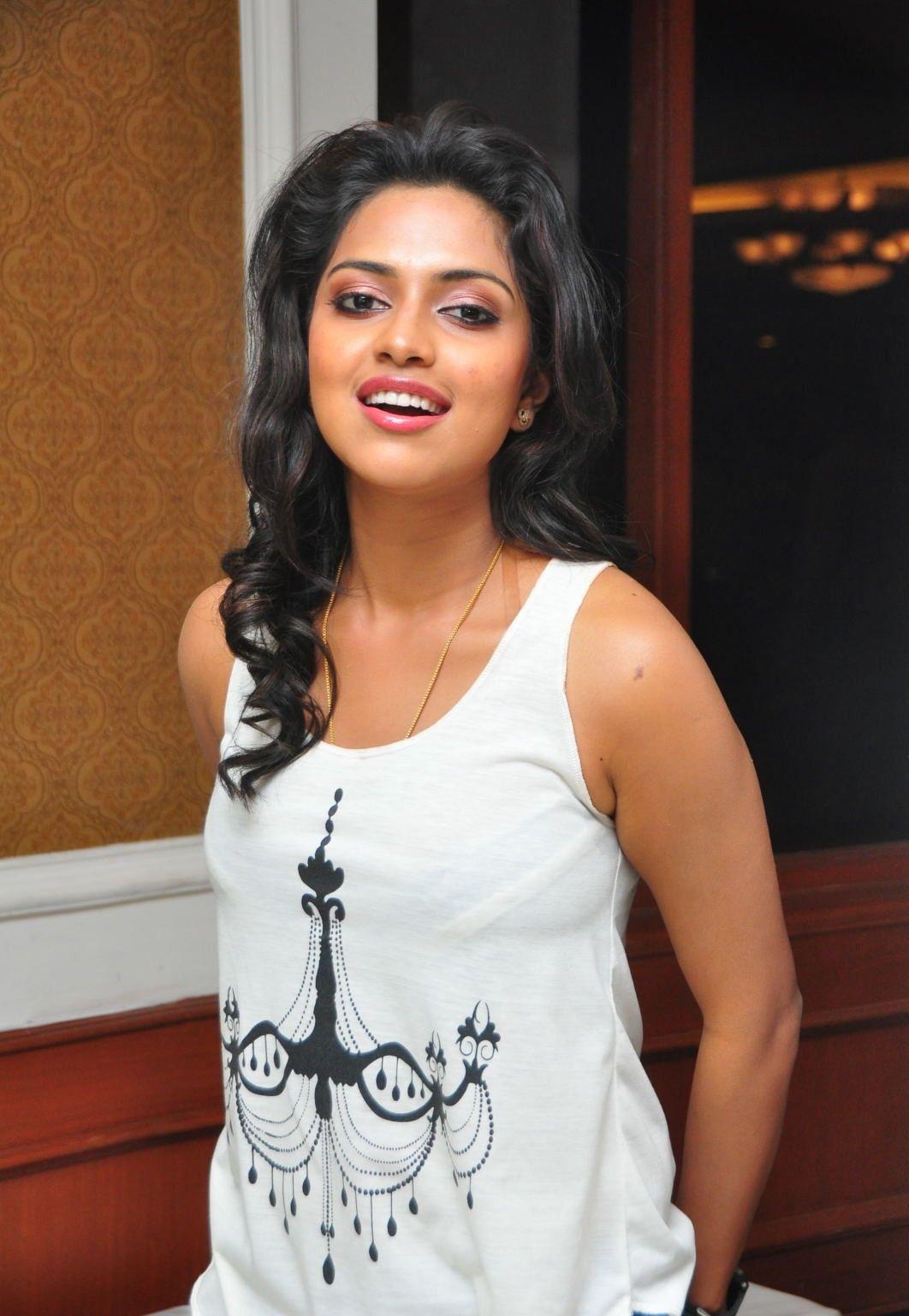 Beautiful Tamil Girl Amala Paul Stills in White Dress Blue Jeans