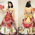 Ela transforma papéis de presentes em vestidos